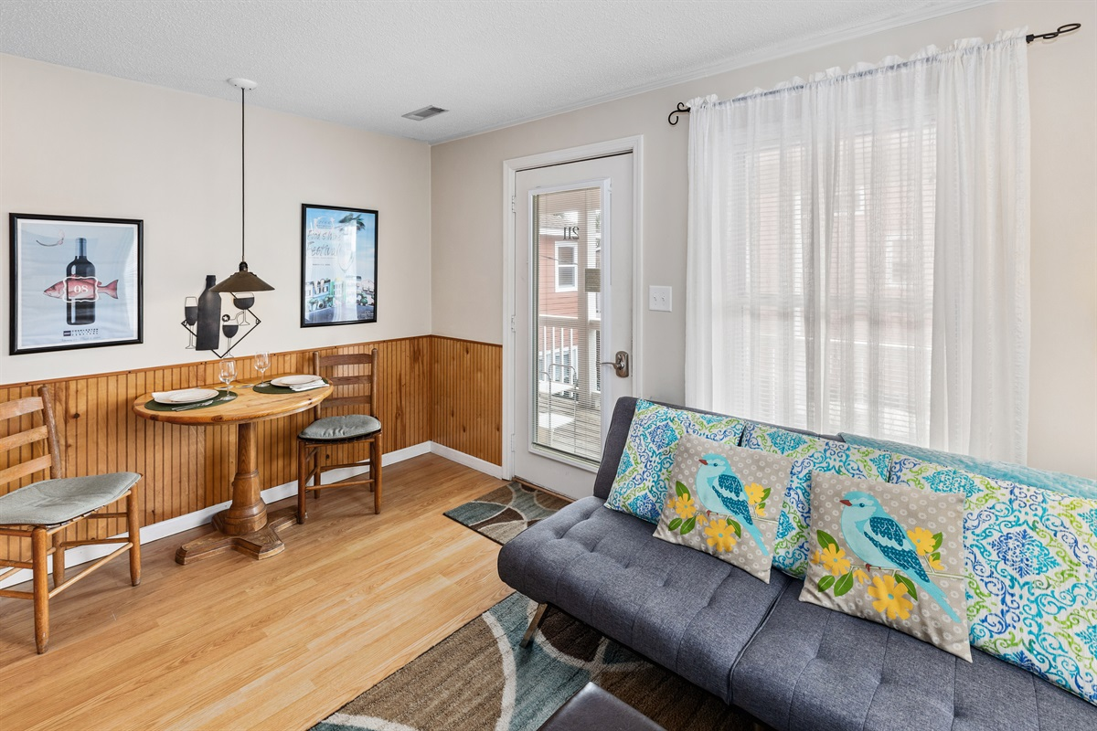 Lots of natural light filters into this condo with three big windows and a French entry door.