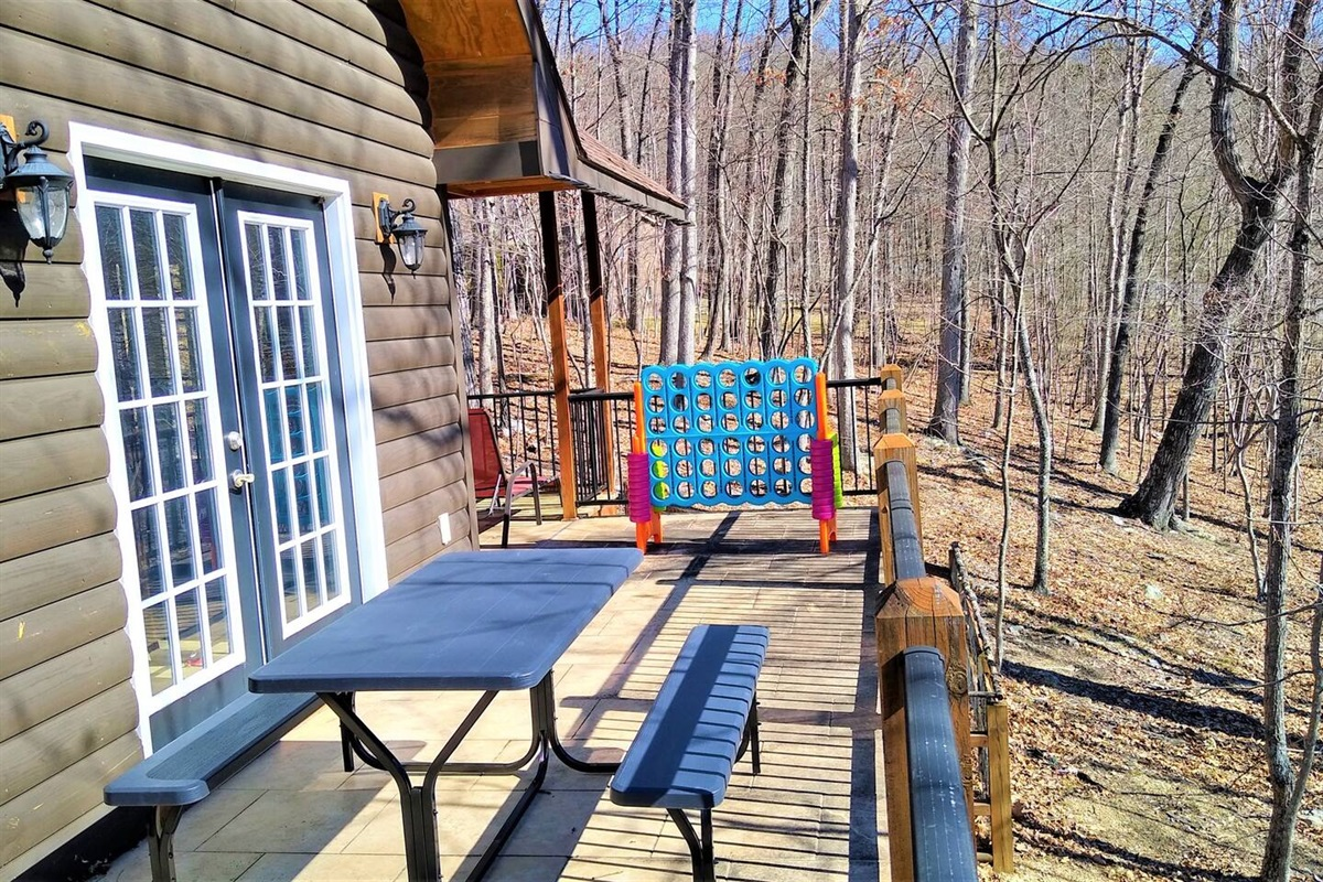 Wrap around balcony with picnic table, huge Connect-4 game and gas bbq grill.