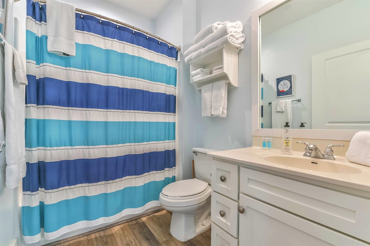 Shared bathroom with shower/tub combo