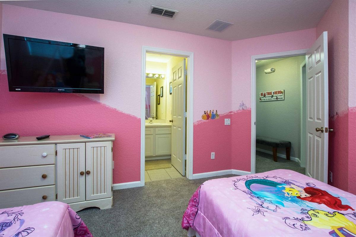 Princess bedroom with flat screen TV.