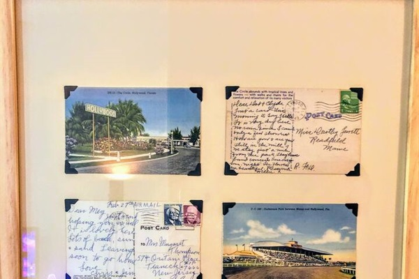 In the living area you'll find vintage postcards hanging on the wall, all the way back from 1940s and 1950s Hollywood, FL!