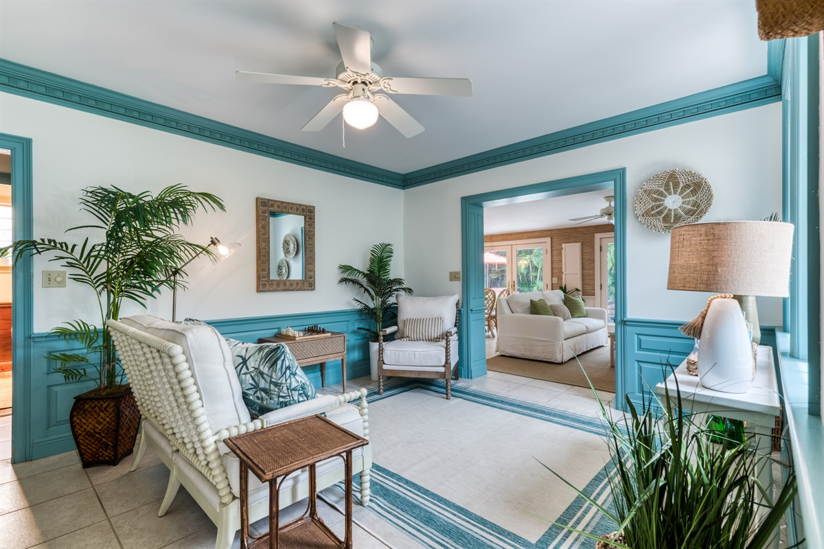 Step inside a Palm Beach tropical setting. Beautiful entrance sitting room with side bar and plenty of light. Decorate palms give you those Florida vibes!