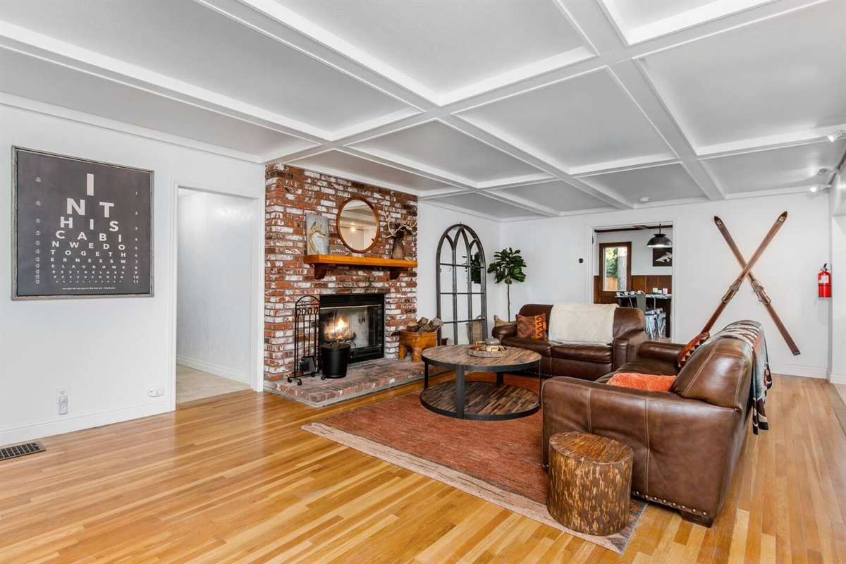 Living Room (Lower Level): Cozy rustic living room with wood burning fireplace. (No TV in the living room)