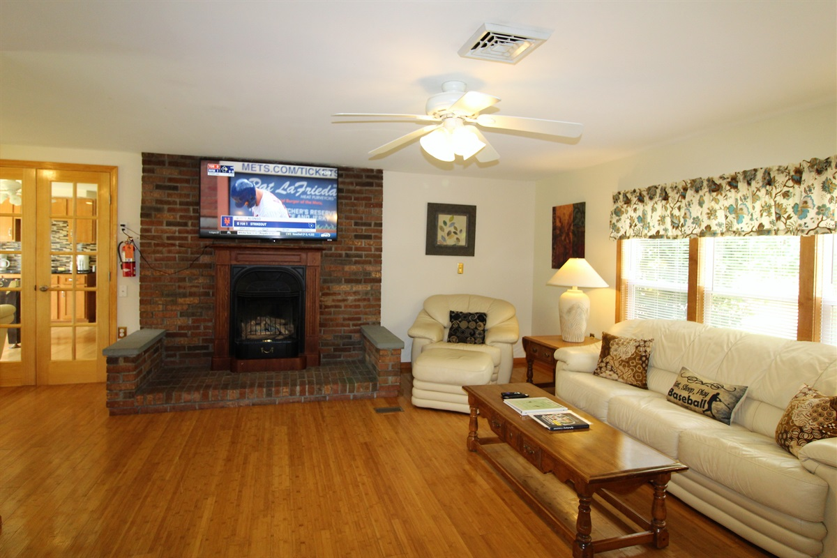 """Large living room with 55"""" (or larger) flat screen TV"""