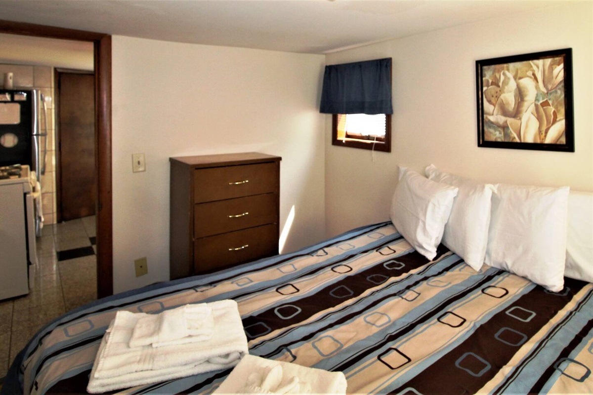 Bedroom with queen bed and central air conditioning makes for a comfortable, quiet night's sleep