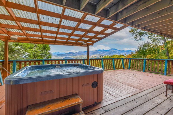 Enjoy the  view from the covered Hot Tub on the lower