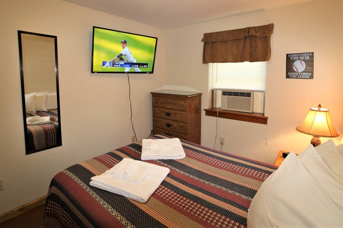 "Bedroom #2 - 43"" (or larger) flat screen smart Roku TV.  Just bring your favorite streaming apps for your viewing pleasure!"