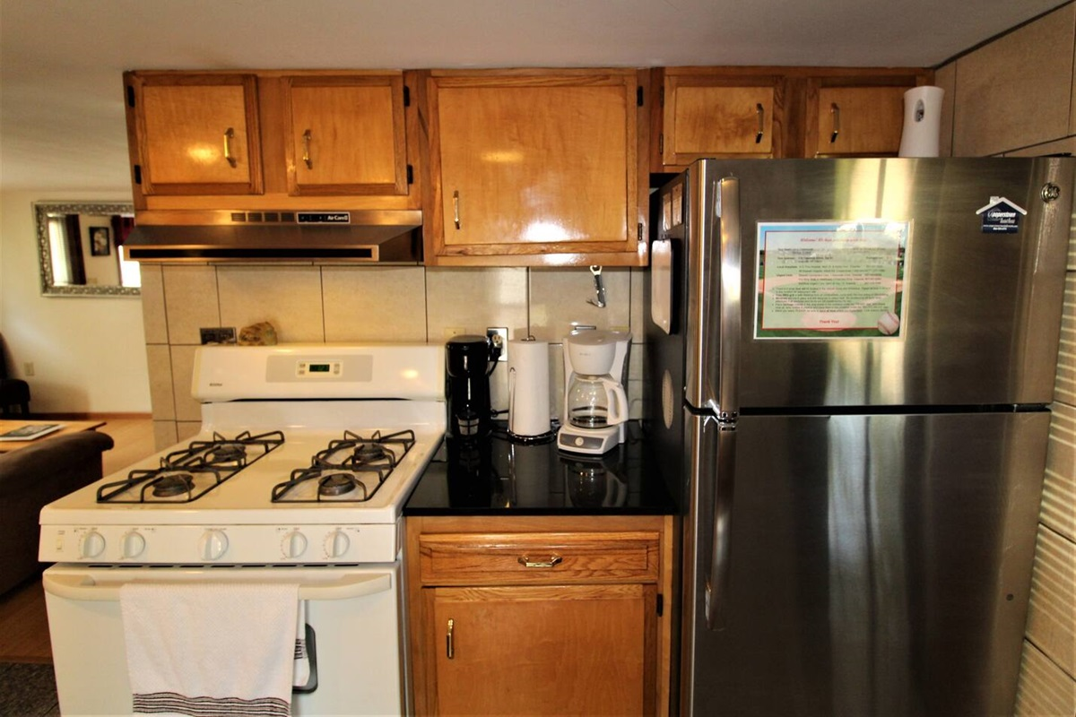 The fully equipped kitchen furnished with all the amenities you need, including a K-cup coffee brewer, blender and full size stainless steel refrigerator with automatic ice maker.
