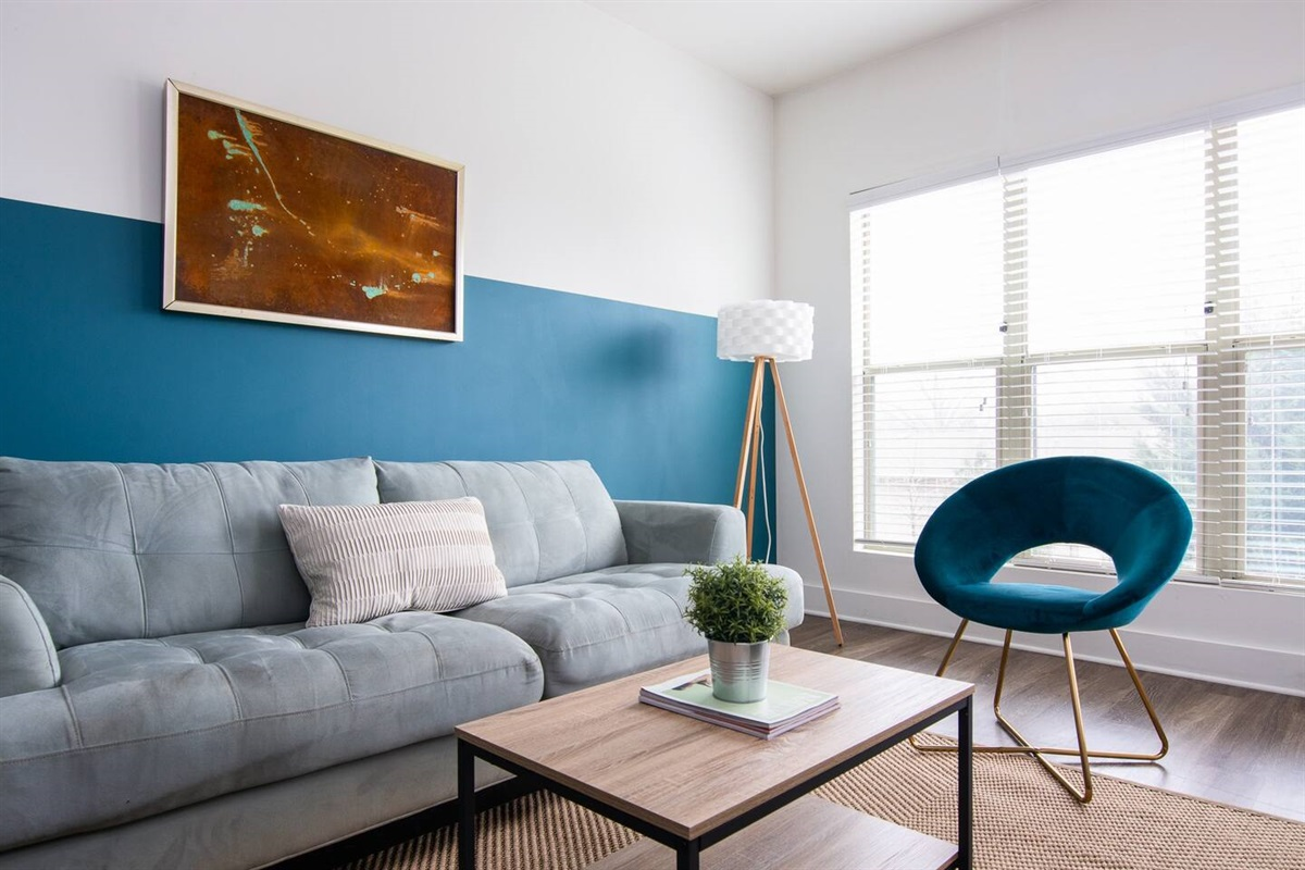 Bright and colorful living room with custom artwork from a Nashville designer.