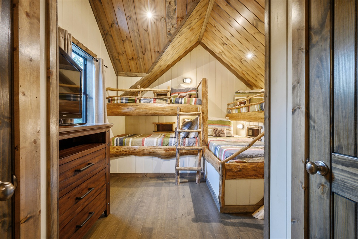 Probably the neatest feature of this cabin is the custom bunk beds built into the room out of wood harvested from the lot during the build
