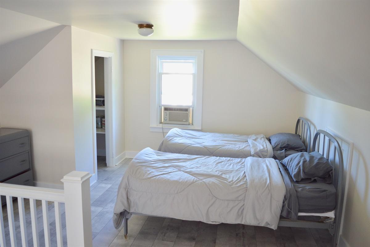 Open concept sleeping area in loft