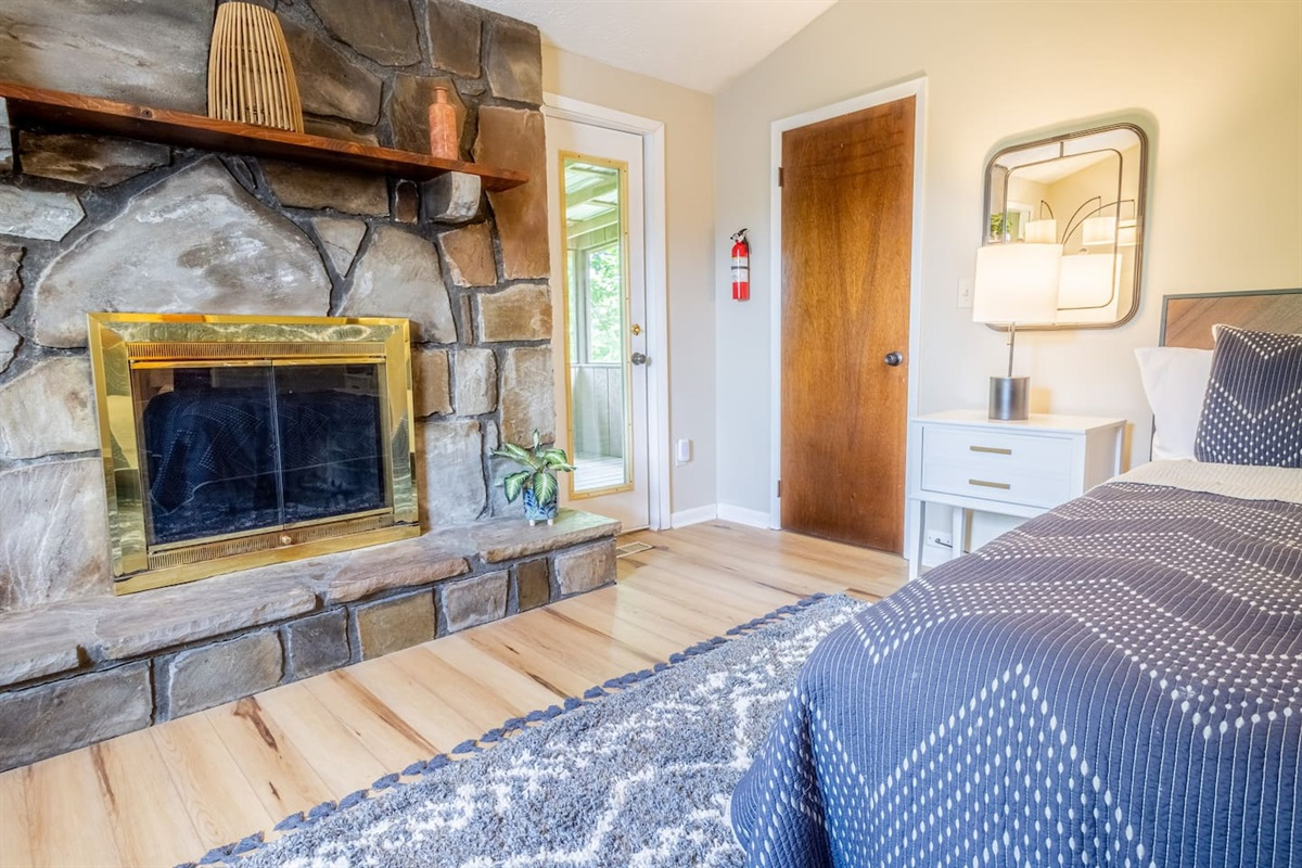 Master bedroom upstairs has its own fireplace