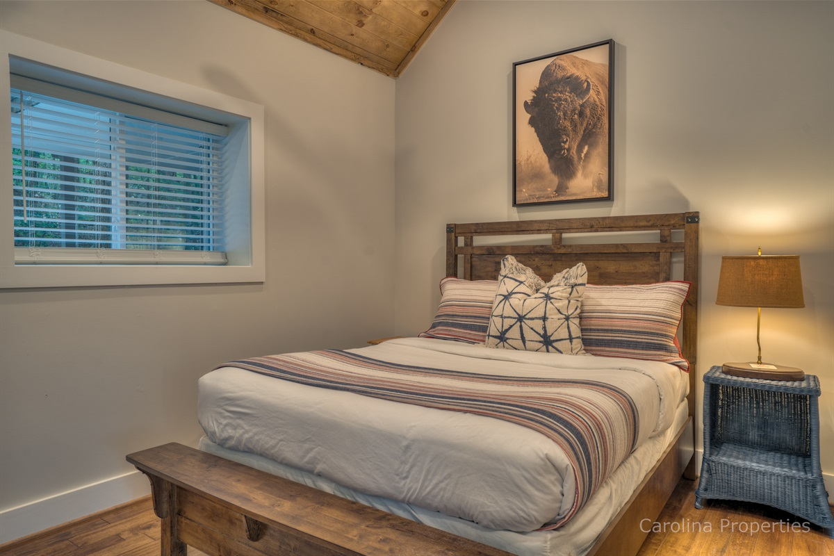 Additional view of bedroom two in the main house with queen size bed