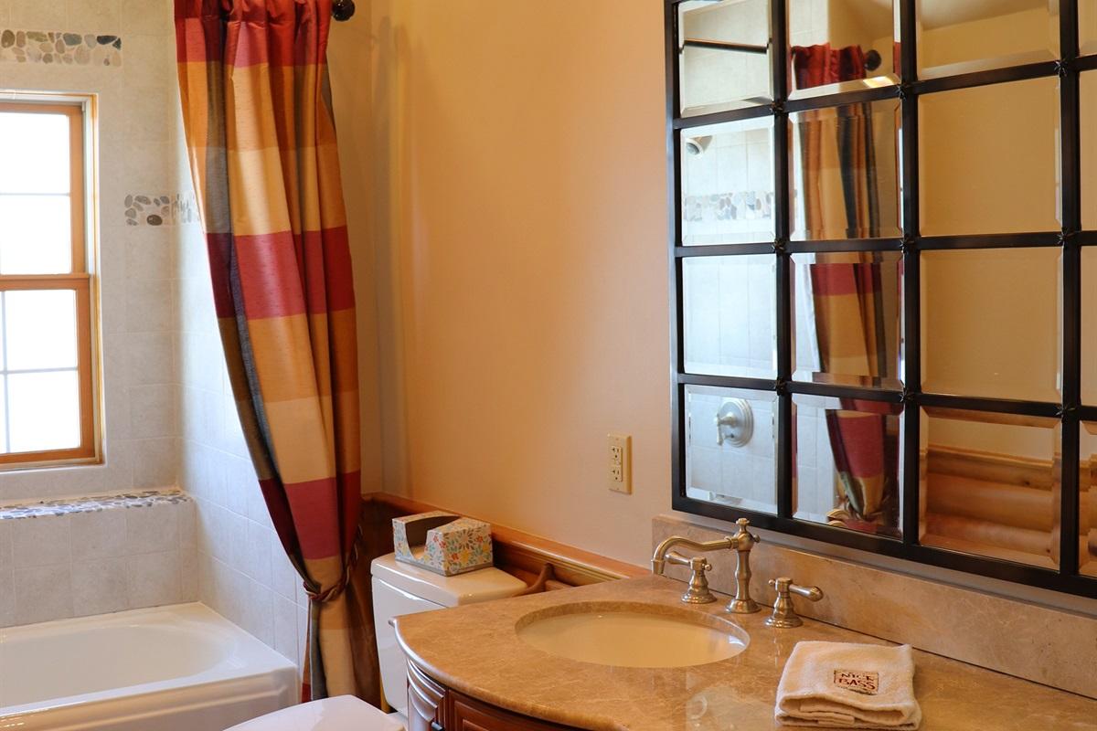 2nd floor Master full bathroom, tub and shower.