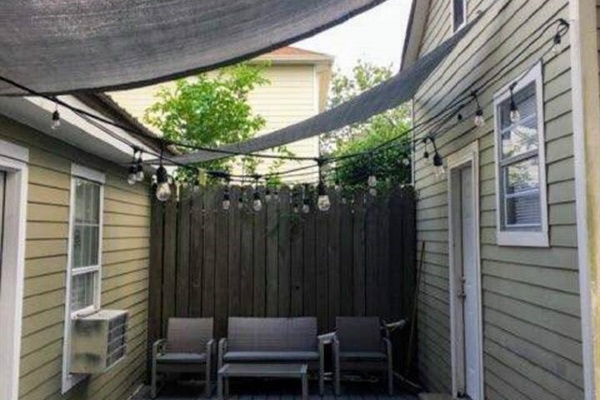 Shaded back patio, out the utility room and also accessible from the driveway.  Area is shared with another apartment.