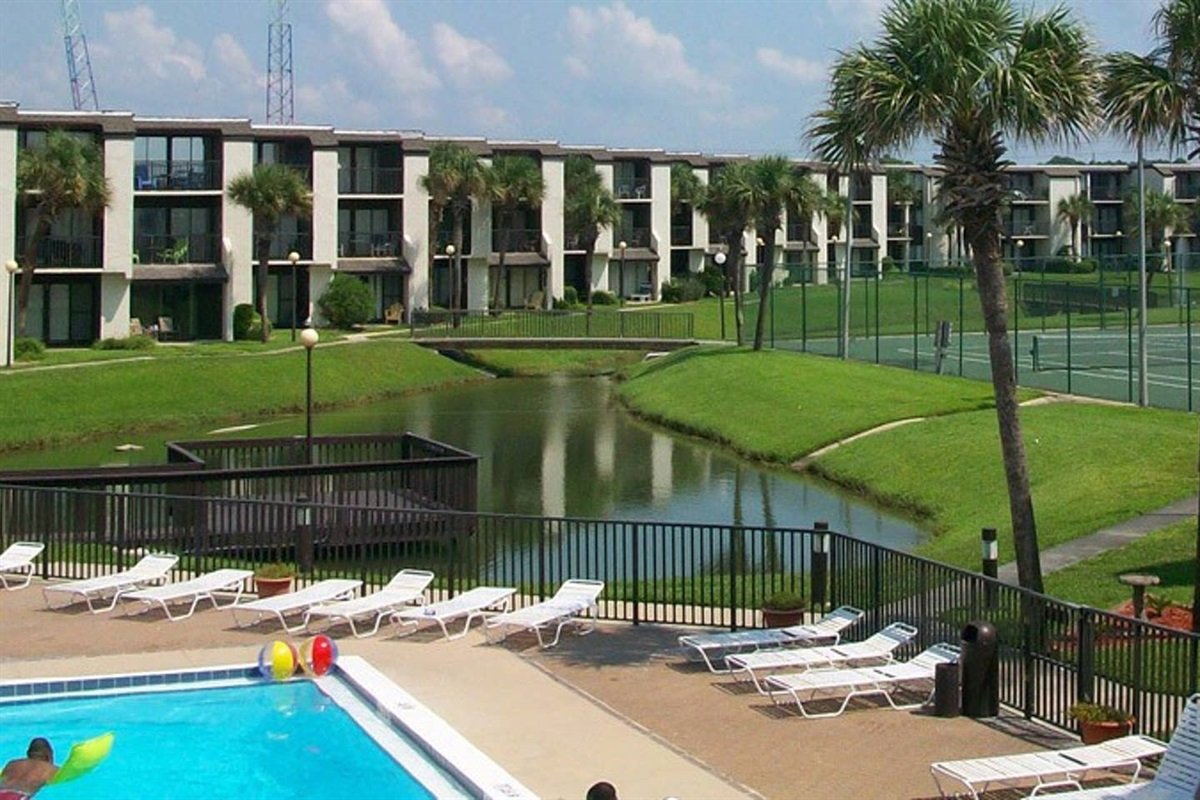 Grounds  with pool, pond and tennis courts