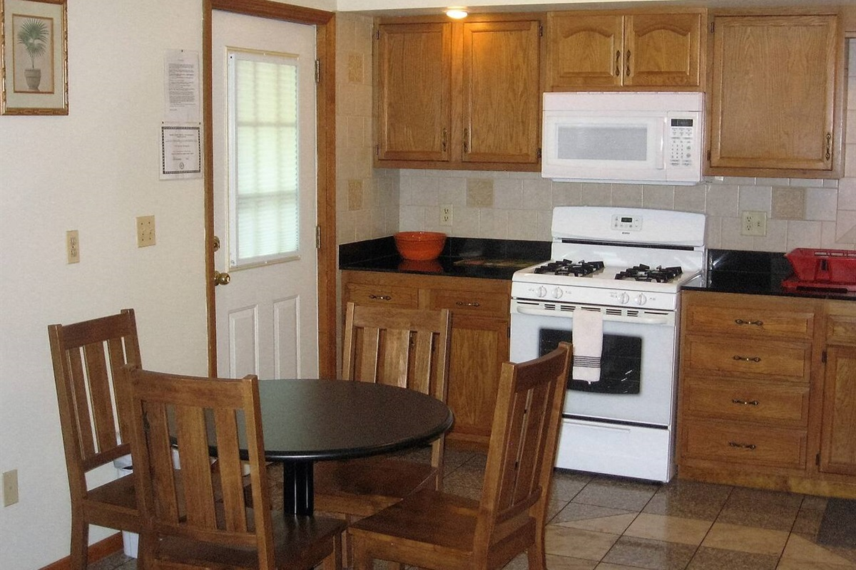 Fully equipped eat-in kitchen with gas stove, over the range microwave, dishwasher and full size refrigerator with automatic ice maker.
