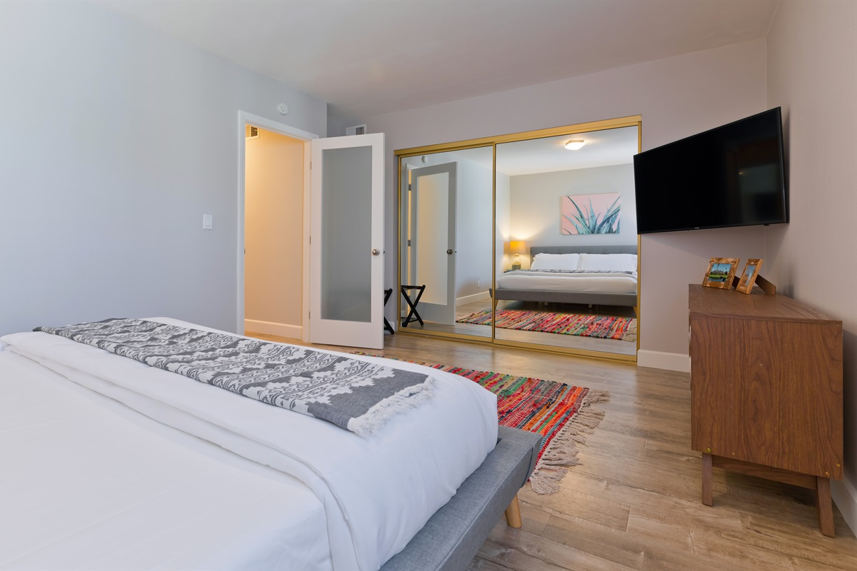 """The couple's suite also has a 48"""" smart TV and full-length closet mirrors."""