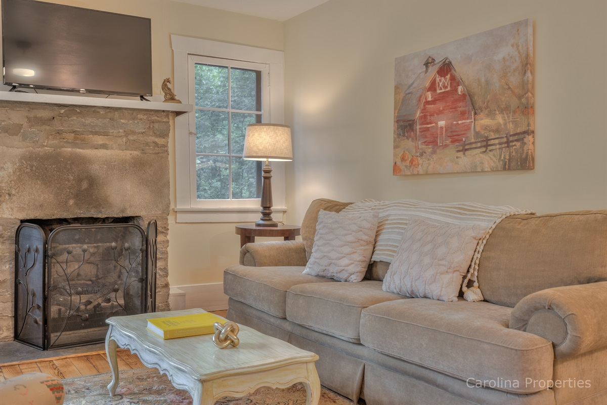 Couch and fireplace in upper level living area