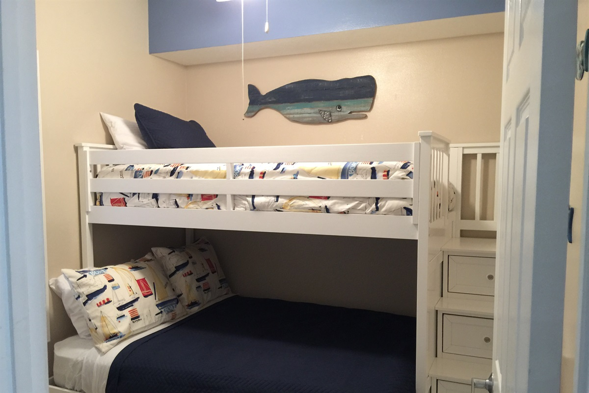 Full size bed on bottom bunk.