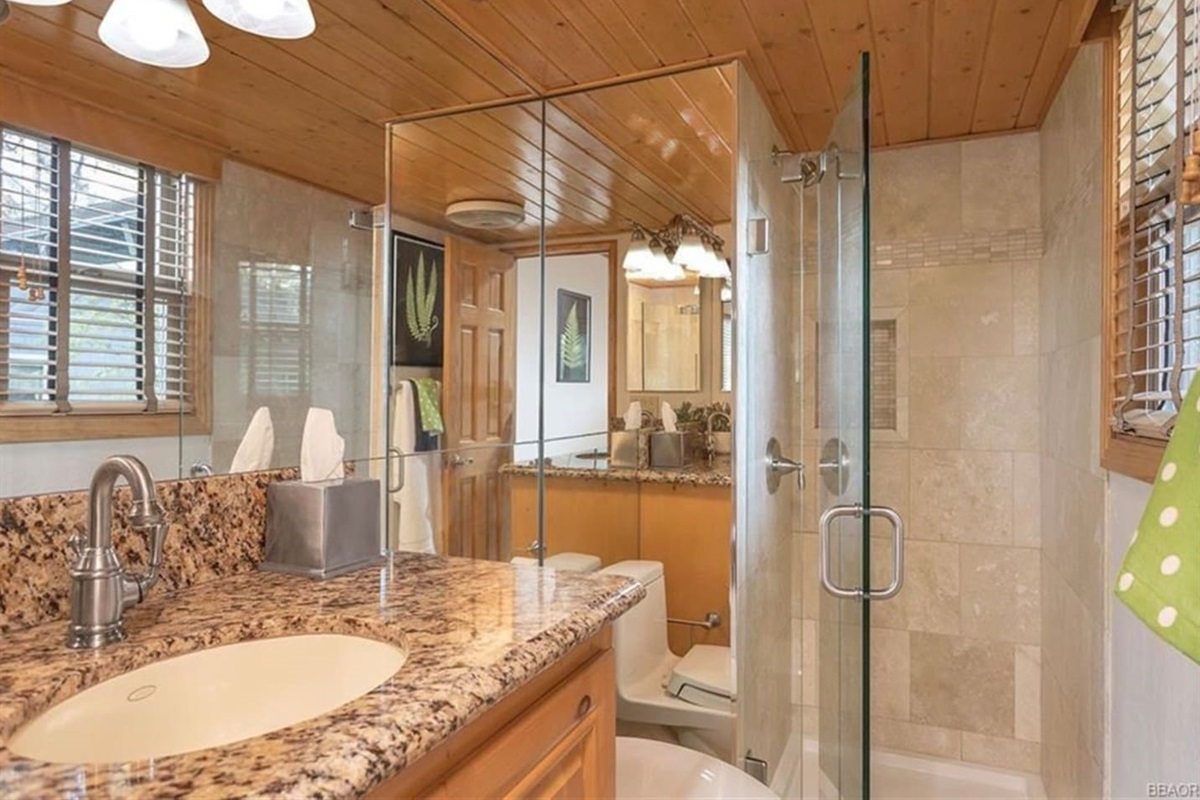 Bathroom #4: Ensuite bathroom to Bedroom #4 with shower and granite countertops.