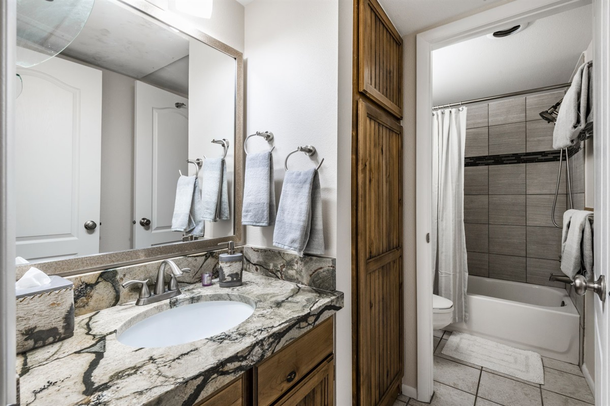 Bathroom with separate vanity area.