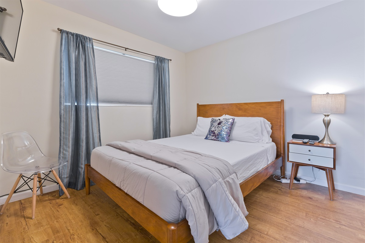 The second guest bedroom is equipped with a queen-size mattress, nightstand, TV, and spacious closet for all of your belongings.