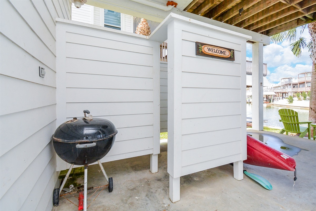 Charcoal grill/outdoor shower/kayak