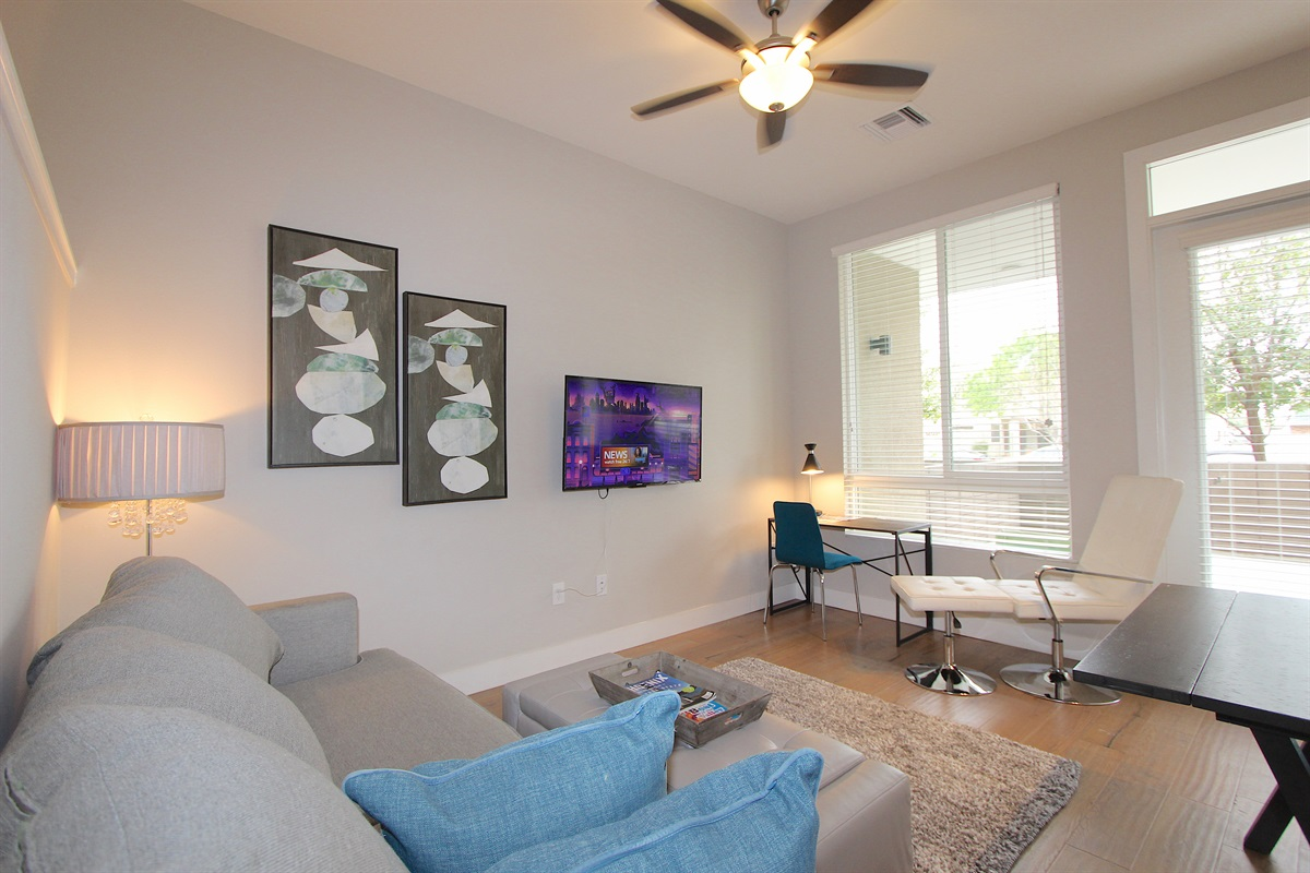 Living area with 50in flatscreen TV with ROKU