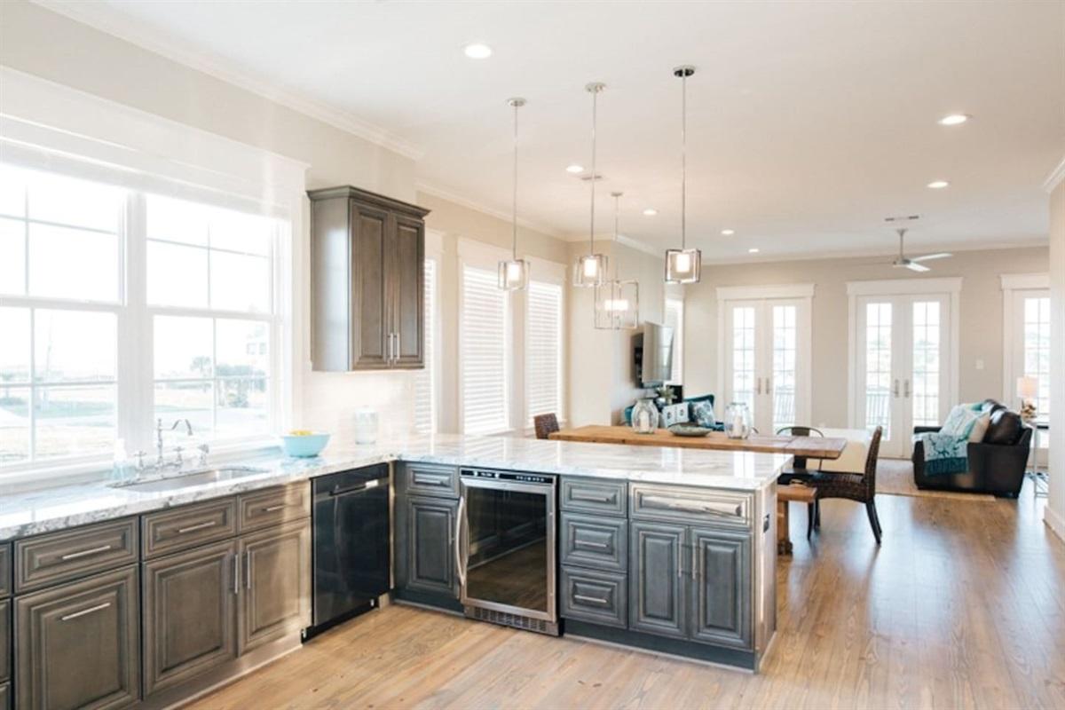 Dark Wood Cabinets & Marble Countertops