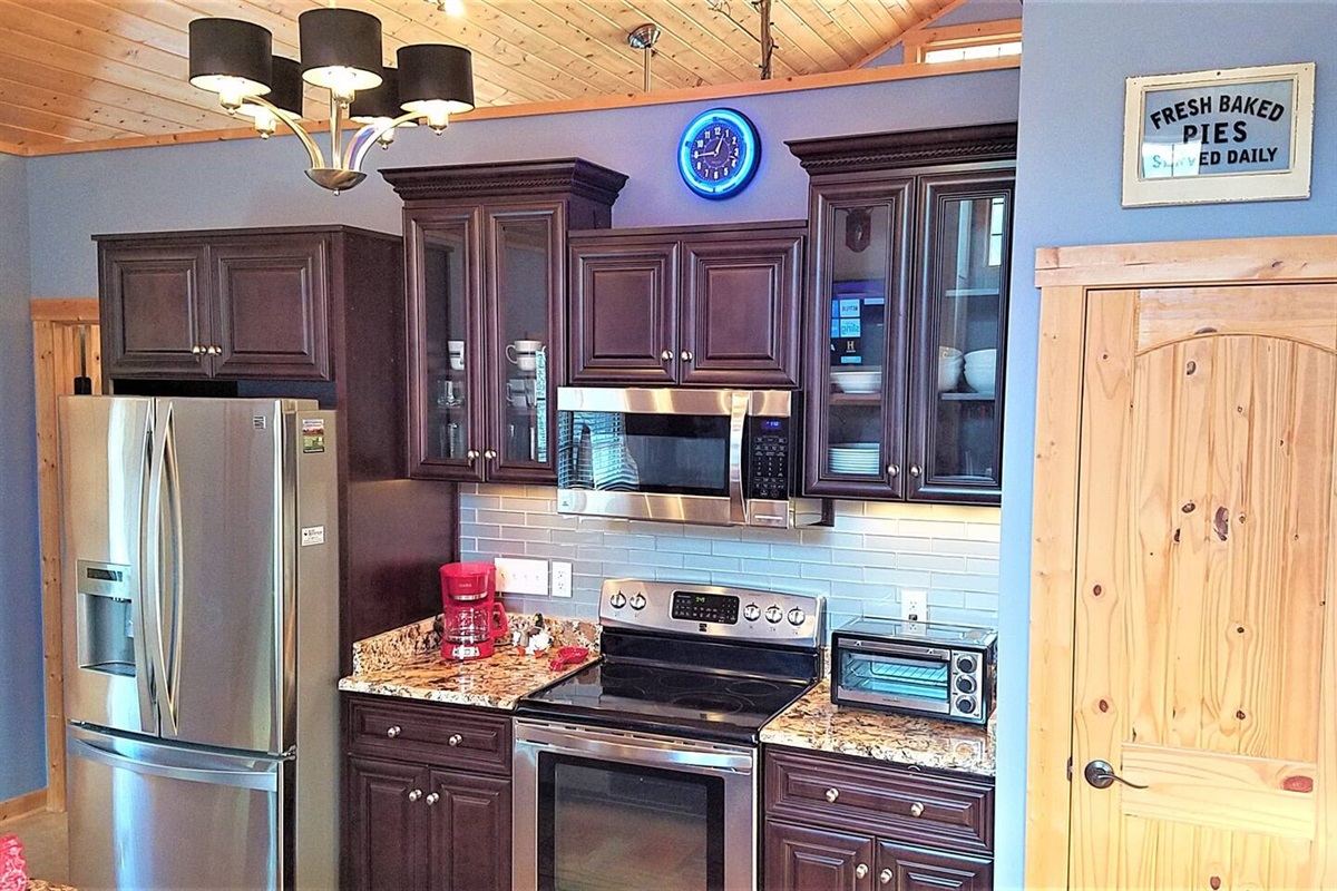Stainless appliances and granite countertops.