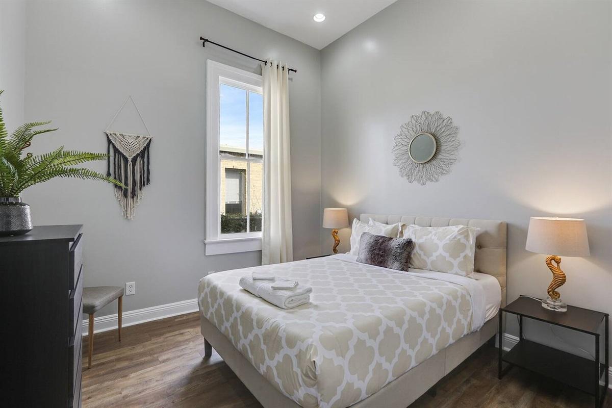 Bedroom 3. Queen bed. Dresser.