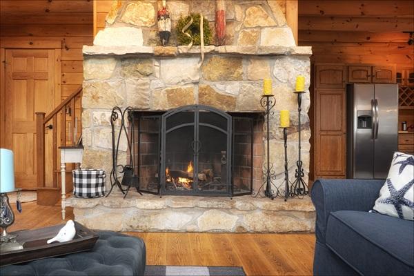 Stunning two story stone wood burning fireplace in the living area