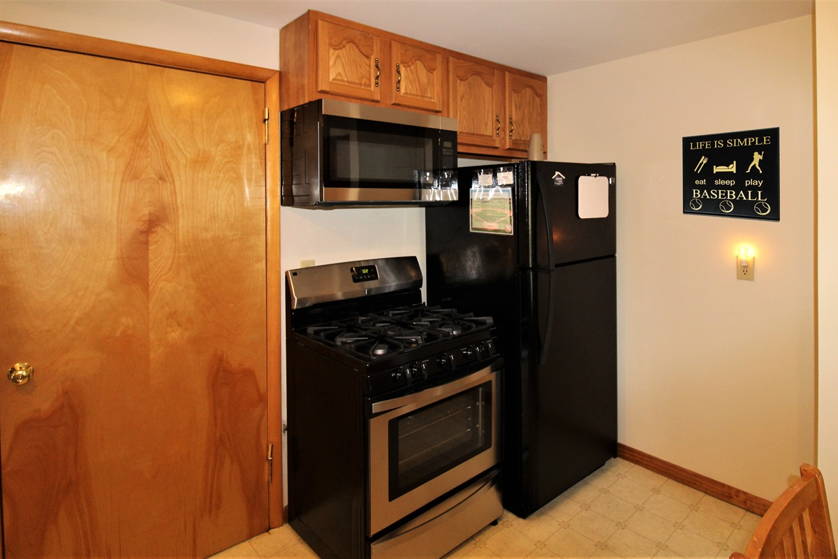 Efficient cooking area with all new appliances.