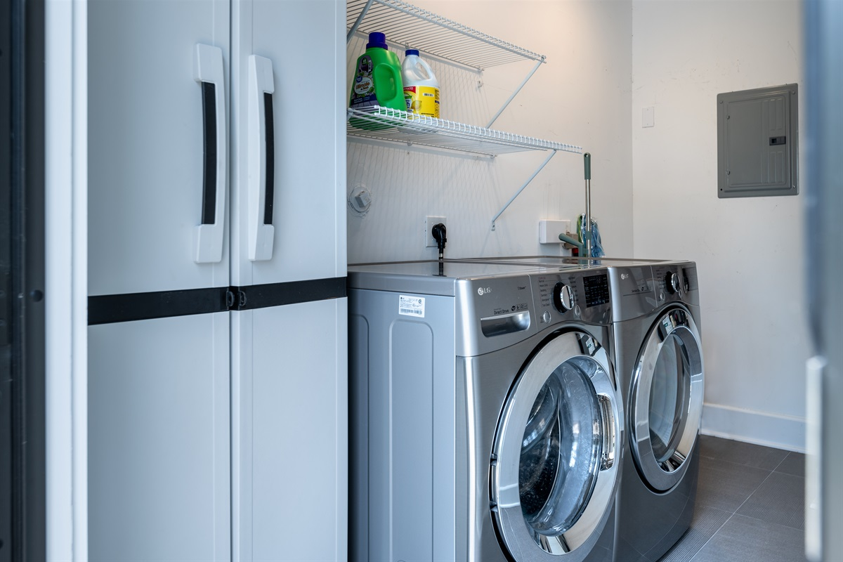Brand new large capacity Washer and Dryer located at the back of the Pool House in it's own space. All detergents and cleaning supplies you need.