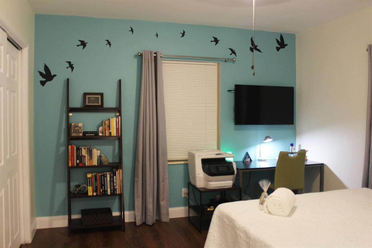 The second bedroom has an office and library, including an HP printer/scanner/copier with 2 trays, heavy-duty stapler, a USB-ready lamp, and other office supplies. The co-working desk is large enough for two people to work comfortably together.