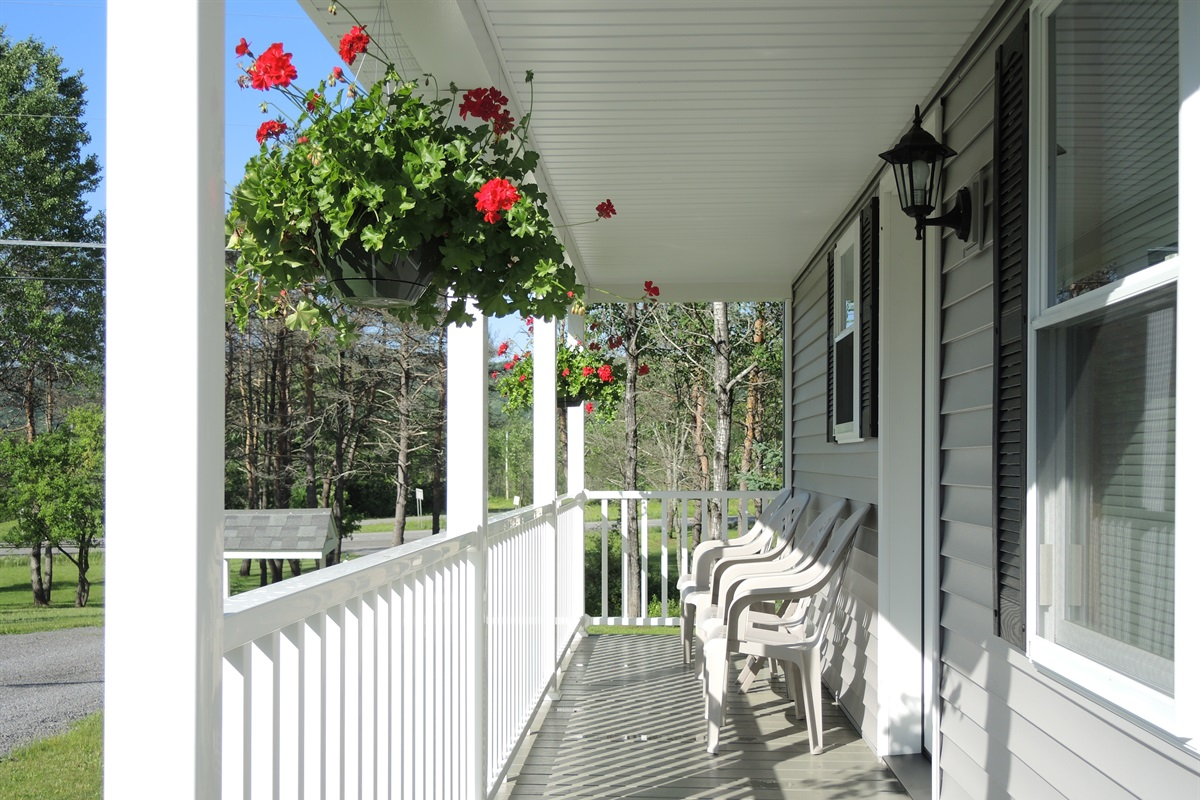 Private covered front porches on each unit