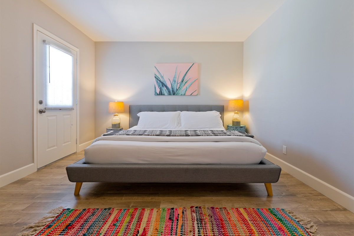 The couple's suite is furnished with a king bed, storage space, and simple yet thoughtful decor.