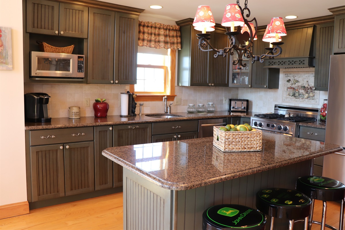 High end kitchen with a large island and lots of prep space.