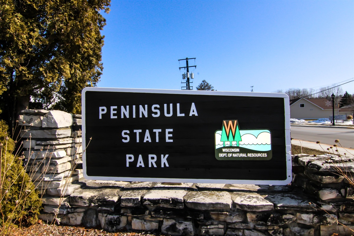 """Arguably the most beautiful park in all of Wisconsin, Peninsula State Park is just moments away from """"Little Yellow Cottage."""" Grab the bikes and hit the trails!"""
