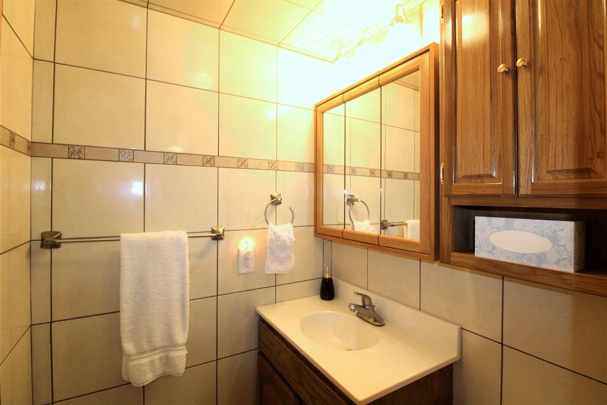 Fully tiled half bath on first floor