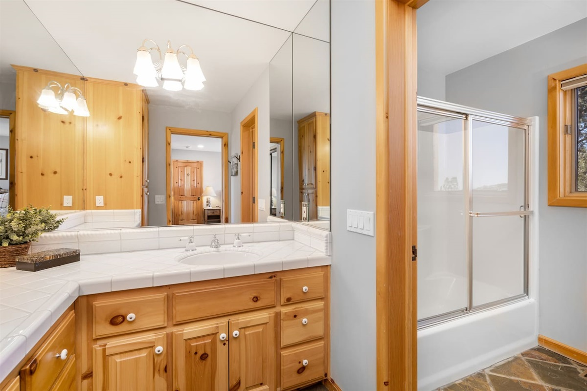 Bathroom #4- full bathroom with a tub/shower combo, located in the downstairs ski- view bedroom. Large built in vanity