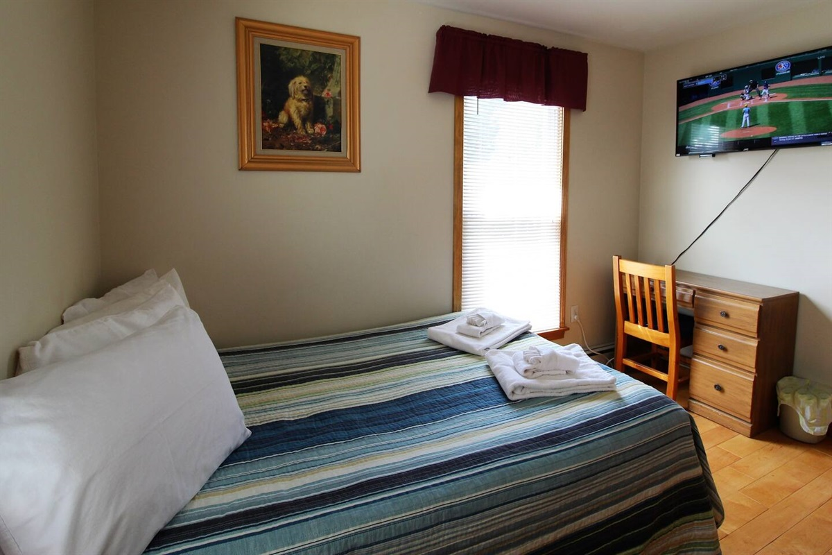 """Bedroom #2 with full size bed and 43"""" (or larger) flat screen smart Roku TV.  A TV in every bedroom means everyone can watch their favorite shows."""