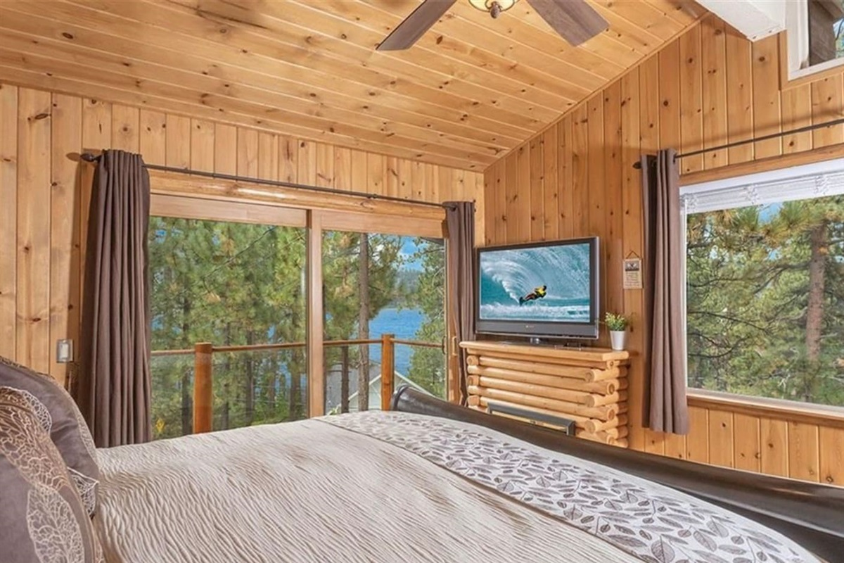 Bedroom #2: It has access to deck, ceiling fan, 1 queen bed, TV, and ensuite bathroom.