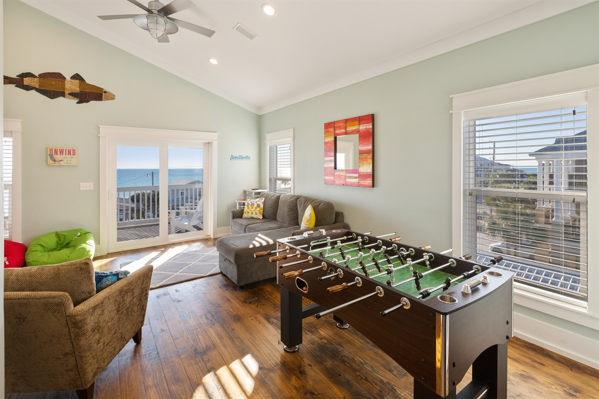 Third floor recreation room offers a great place for games, movies or relaxing while taking in the views. There is a sofabed for added sleeping accommodations.