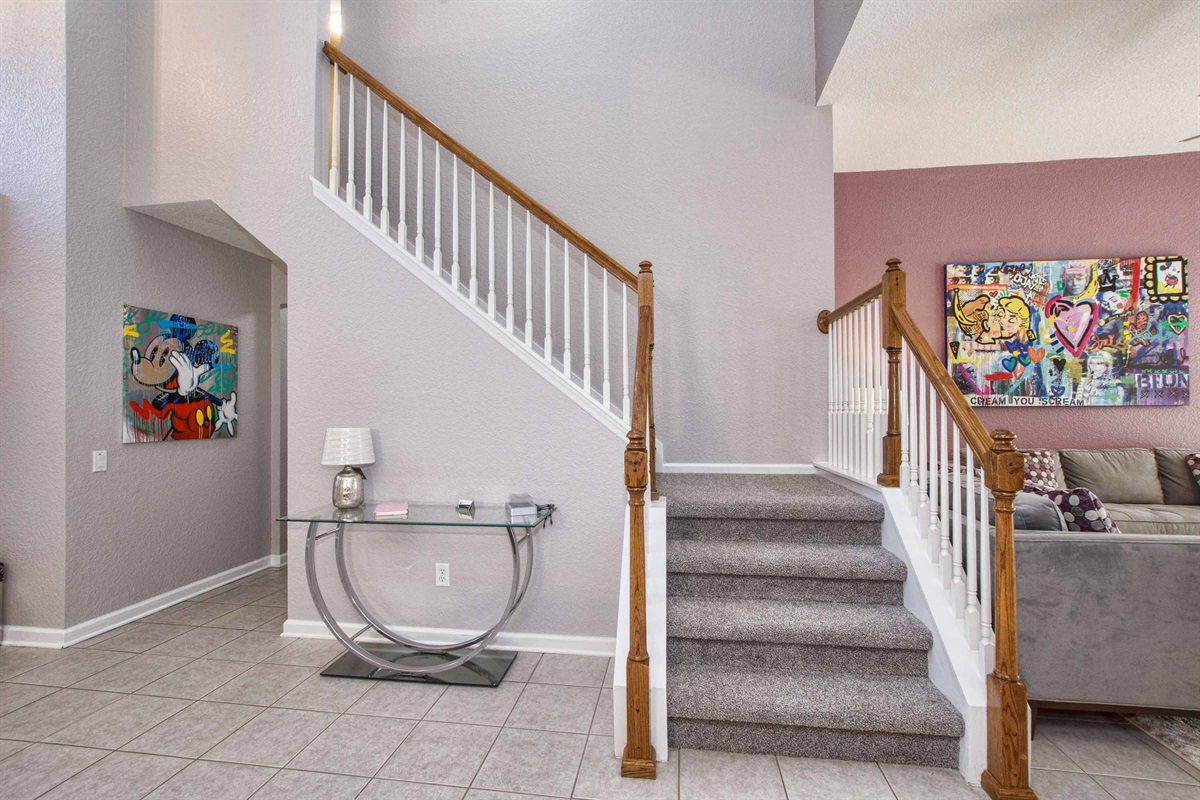 Stairway leads to the two themed kids rooms.