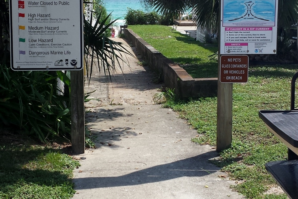 No steps from our house until you step down onto the sand at the end of the walkway. Easy access for all of your favorite beach items.