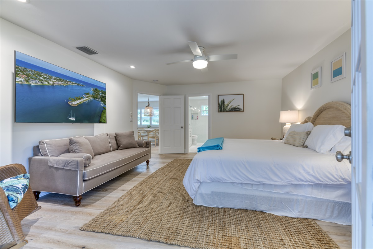 """Large Master King Bedroom with En-suite bathroom. Huge 65"""" Smart TV with full cable. Stunning bedroom with walk-in closet. Step outside onto the patio and enjoy the outdoor furniture."""