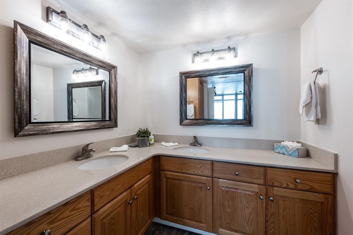 Master bedroom has ensuite bathroom with separate vanity area.