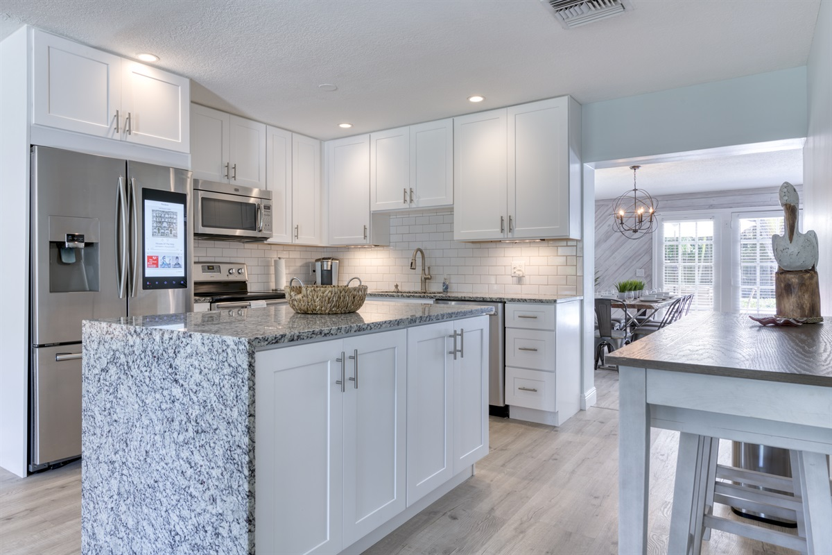Open plan upgraded kitchen with marble counter tops, stainless steel appliances & Smart Fridge!